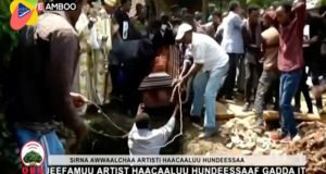In this image taken from OBN video, the coffin carrying Ethiopia singer Hachalu Hundessa is lowered into the ground during the funeral in Ambo, Ethiopia, on Thursday. Photograph: OBN via AP