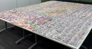 Cash seized in Operation Venetic, an investigation on Encrochat, a military-grade encrypted communication system used by organised criminals trading in drugs and guns. Photograph:  WMROCU/PA