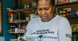 The 'UnBlocked Cash' project is currently undergoing a second-phase trial in Vanuatu with more than 5,000 individuals and 100 vendors participating. Photograph: Keith Parsons/Oxfam