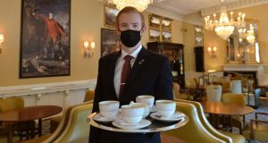 Gary Cahill, food and beverage director at the Shelbourne, serving coffee in the Lord Mayor's Lounge. Photograph: Alan Betson