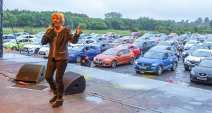 Philomena Begley performing for drive-in revellers, who have packed a football ground for Northern Ireland's first drive in country music concert at Ballymena Showgrounds in Co Antrim. Photograph: Paul Faith/PA Wire