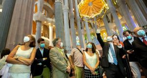 Architect Jordi Fauli (second right) explains to the visitors the details of Sagrada Familia in Barcelona, Catalonia, Spain. Photograph: Enric Fontcuberta/EPA