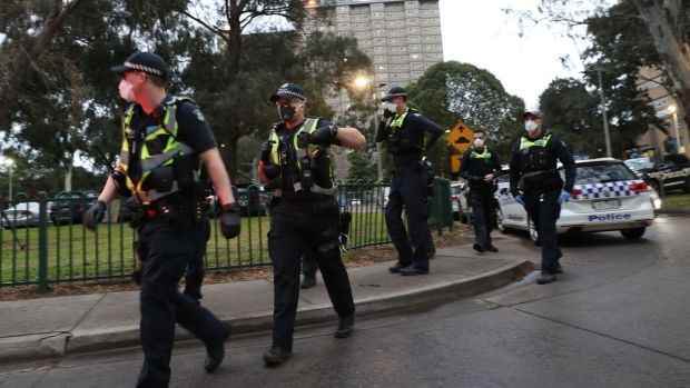 Police enforce a lockdown at public housing towers on Racecourse Road in Flemington, Melbourne, Australia. Photograph: David Crosling/EPA