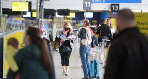 Passengers at Dublin Airport prepare for their trips. Photograph: Dara Mac Dónaill