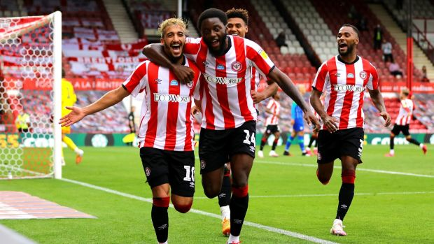 Brentford's Said Benrahma (L) celebrates scoring his hat-trick with teammates Josh Da Silva and Ollie Watkins. Photograph: Aaron Chown/PA