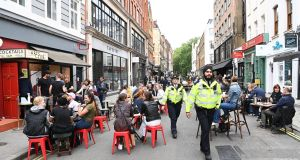 People enjoy a day at the pubs in Soho, London following their reopening on Saturday. Photograph: Facundo Arrizabalaga/EPA