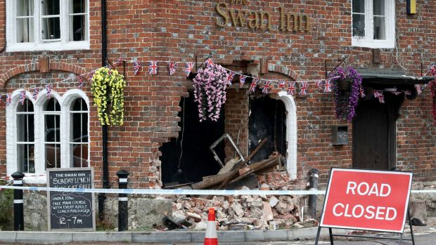 Irish backstop - The Swan Inn in Ashford, Kent, after a car crashed into the pub during the early hours of this morning. Photograph: Gareth Fuller/PA Wire