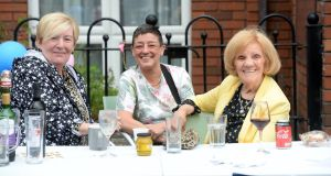 Tina Ward, Tanya Maher and Maura Cudden, enjoy the celebrations at Wolfe Tone Close, Wolfe Tone Street, Dublin 1. Photograph: Dara Mac Dónaill