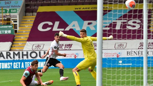 Sheffield United's Irish defender John Egan scores a late equaliser at Turf moor. Photograph: Peter Powell/Getty/AFP
