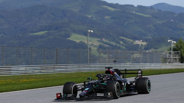 Defending world champion lewis Hamilton was demoted from second to fourth in Austria. Photograph: Mark Thompson/AFP/Getty