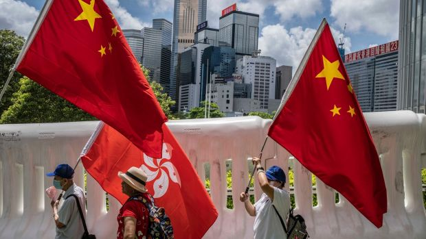 Supporters of the government in Beijing march in Hong Kong. Photograph: Lam Yik Fei/The New York Times