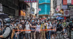 Demonstrators at Causeway Bay protest China's new security law. Photograph: Lam Yik Fei/The New York Times