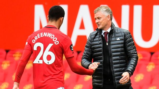 Ole Gunnar Solskjaer congratulates Mason Greenwood after his brace against Bournemouth. Photograph: Peter Powell/AFP/Getty
