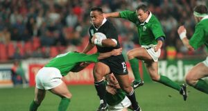 Jonah Lomu runs through the Ireland defence at Ellis Park in Johannesburg during the 1995 Rugby World Cup. Photograph: Billy Stickland/Inpho