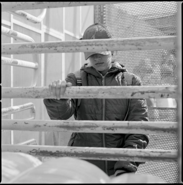 A woman porter at the Barrio Chino border.