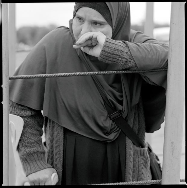 A woman waits at the Barrio Chino border crossing.