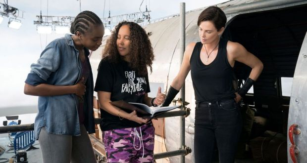 Gina Prince-Bythewood, centre, with KiKi Layne and Charlize Theron on the set of The Old Guard. Photograph: Aimee Spinks/Netflix