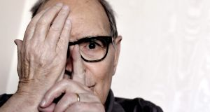 Italian composer Ennio Morricone poses during an interview in Rome in 2017. The composer has died, aged 91. Photograph: Tiziana Fabi/Getty