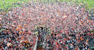 Armagh fans spill on to the Croke Park pitch after their win over Tyrone in the  Ulster SFC Final replay in July 2005. Photograph: Donall Farmer/Inpho