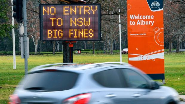 A sign in the southern New South Wales (NSW) at the border city of Albury. Photograph: William West/ AFP/Getty