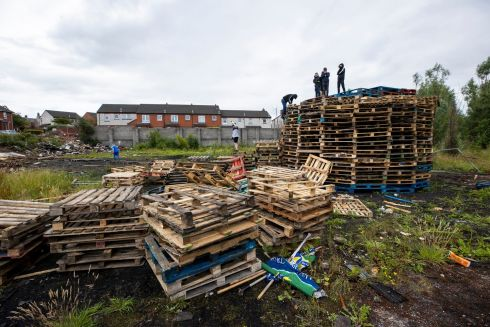ELEVENTH HOUR: Preparations are made for an Eleventh night bonfire in the Lismore Road area of east Belfast. Local MP Gavin Robinson has appealed for those building loyalist bonfires to behave responsibly, amid the coronavirus pandemic. Photograph: Liam McBurney/PA Wire