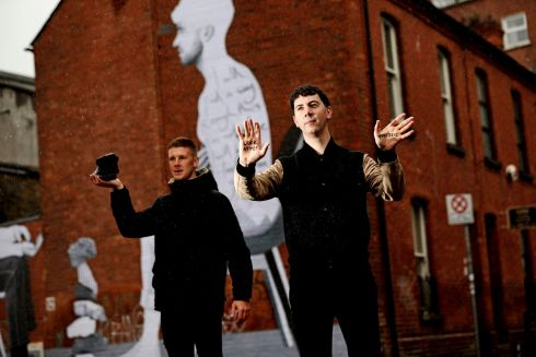 REACHING OUT: Former Dublin GAA player and Irish Association of Counsellors and Psychotherapists ambassador Shane Carthy and street artist Joe Caslin at the unveiling of mural on Montague Lane, Dublin 2, which aims to encourage men to seek therapy if they need it. Photograph: Julien Behal