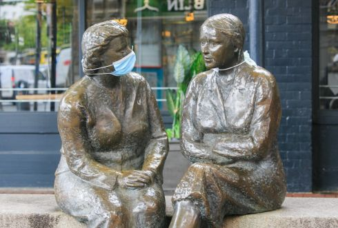 MASK UP: Face masks on The Meeting place sculpture on Liffey Street, Dublin. Photograph: Gareth Chaney/Collins