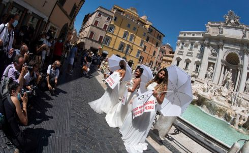 JILTED: Demonstrators take part in a flash mob protest in the Trevi Fountain in Rome over the forced postponement of weddings. Photograph: Claudio Peri/EPA