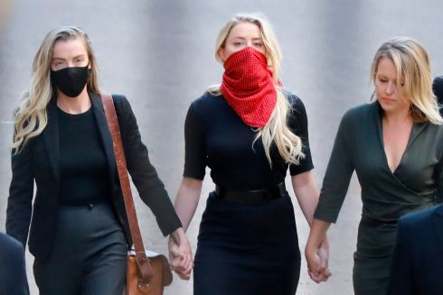 MAKE YOURSELF HEARD: Actor Amber Heard (centre) arrives on the first day of libel trial brought by her former husband Johnny Depp against News Group Newspapers in London. Photograph: Tolga Akmen/AFP via Getty Images