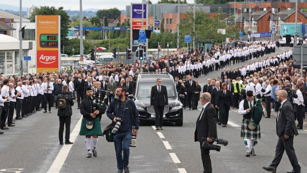 The funeral procession of former leading IRA figure Bobby Storey in west Belfast. Who were the men dressed in a uniform of black slacks, white shirts and black ties? Photograph: Liam McBurney/PA Wire