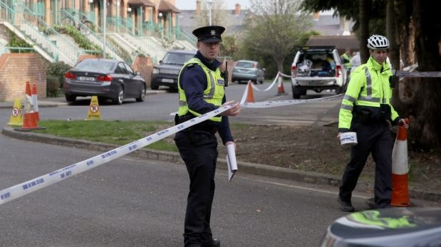 Gardaí at the scene in Rathmines, Dublin, last April where the remains were found on a tree-lined common area close to apartments. Photograph: Brian Lawless/PA Wire