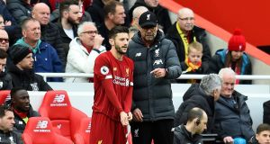 Jürgen Klopp talks to Adam Lallana during their match against Bournemouth at Anfield in March. Photograph: Andrew Powell/Liverpool FC via Getty Images