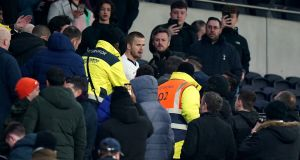 Tottenham Hotspur's Eric Dier confronts a supporter in the stands following the FA Cup fifth round match against Norwich at Tottenham Hotspur Stadium. Photo: PA Wire/PA Wire
