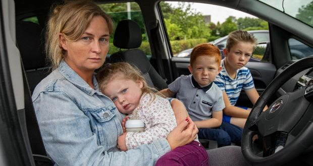 Roseanne Joyce with three of her five children – Johanna Rose, David and Danny – in the car they live in outside the offices of Tipperary County Council in Nenagh. Photograph: John D Kelly