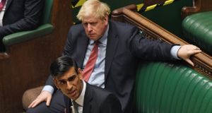 Britain's prime minister Boris Johnson and chancellor of the exchequer Rishi Sunak: Employers who bring back someone furloughed and keeps them on the payroll until January will receive a £1,000 bonus.  Photograph: Jessica Taylor