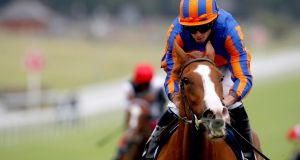 Love, ridden by jockey Ryan Moore, winning the Oaks at Epsom. Photograph:  Dan Abraham/PA