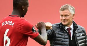 Manchester United  manager Ole Gunnar Solskjaer congratulates   midfielder Paul Pogba in their clash against Bournemouth at Old Trafford last week. Photograph: Peter Powell/AFP