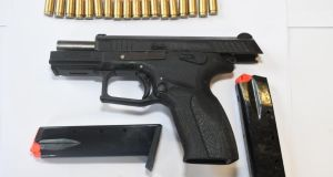 The firearm, a magazine and ammunition were discovered wrapped in plastic and buried on the site.