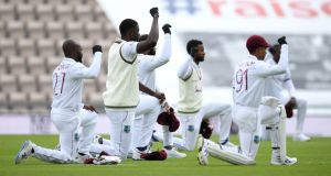 West Indies captain Jason Holder and his teammates take a knee during day one of the first Test against England. Photograph: Mike Hewitt/Getty