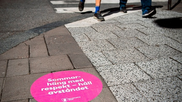 "A sticker on the streets of Stockholm translates to: ""summer hang out with respect, keep the distance."" File photograph: Getty Images"