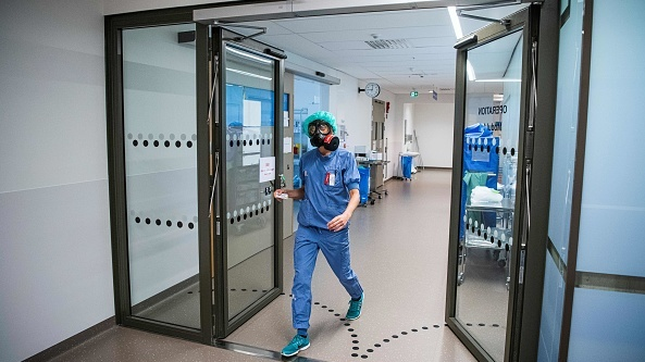 Irish backstop - A doctor in an intensive care unit (ICU) in Stockholm's Sodersjukhuset hospital wearing a protective face mask after treating patients with Covid-19. File photograph: Getty Images
