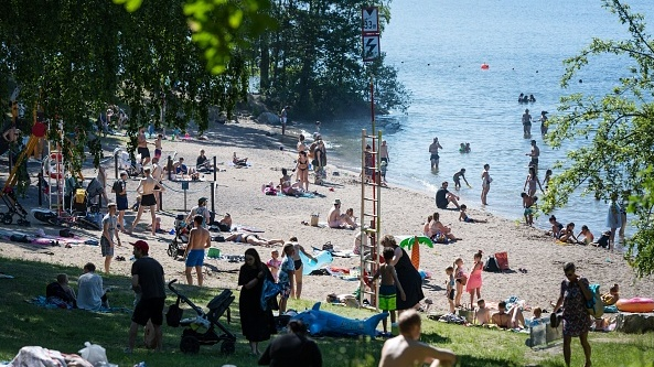 People enjoy summer temperatures at Malarhojdsbadet beach at the lake Malaren in Stockholm, Sweden last month. File photograph: Getty Images