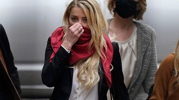 Amber Heard arrives at court. During proceedings her ex-husband Johnny Depp denied attacking Heard while undergoing detox to ease himself off prescription drugs on his private island in the Bahamas in August 2014. Photograph: EPA