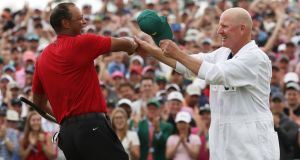 Tiger Woods celebrates with caddie Joe LaCava after winning the 2019 Masters in Augusta, Georgia. Golfers will be desperate to play in this year's Masters, be it their first or 25th. Photograph: Jonathan Ernst/Reuters