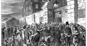 Illustration of starving people at a workhouse gate during the Famine. From The Life and Times of Queen Victoria by Robert Wilson, (1900). Photograph: The Print Collector/Print Collector/Getty Images