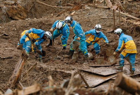 Police rescuers search for missing people at Tsunagi in Kumamoto Prefecture on the Japanese southwestern island of Kyusu, after landslides caused by torrential rain. Fifty-nine people are confirmed to be dead and another are 16 missing on Kyushu island. Photograph: Kimimasa Mayama/EPA