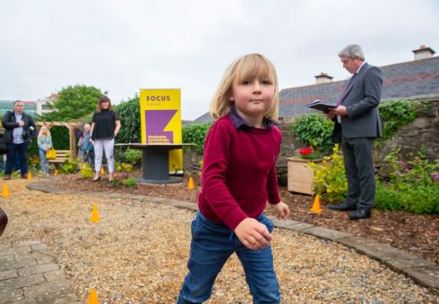 Emanuel Hoole (4) at a Focus Ireland ceremony to award graduates of its Preparation for Education, Training and Employment course and unveil a new garden project at Parliament Street, Waterford City. Photograph: Patrick Browne