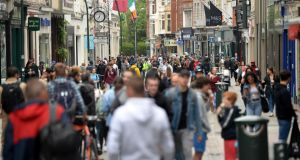 Economic recovery will  be aided by a possible consumer boom. With restrictions on spending and heightened caution, household savings are rising rapidly. Photograph:  Dara Mac Dónaill