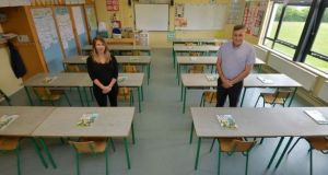 Monica Hickey, 5th class teacher, and Matt Melvin, school principal, at St Etchen's National School, Kinnegad, Co Westmeath in a classroom that can now accommodate 20 pupils according to the HSE guidelines on social distancing in schools. Photograph: Alan Betson