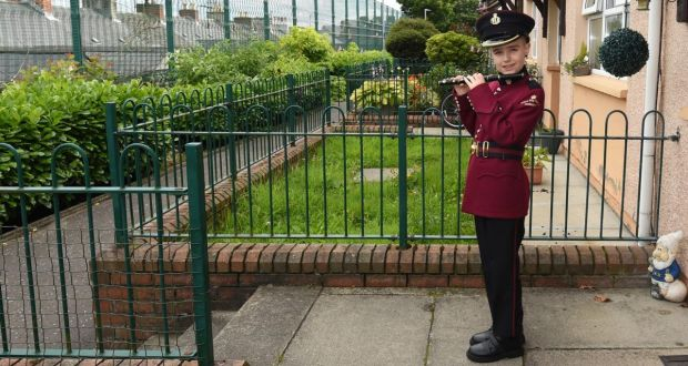 Ten-year-old Jonathan Thompson is the youngest flute player with the William King Memorial Flute Band. He is practising outside his home in the Fountain in Derry. Photograph: Trevor McBride